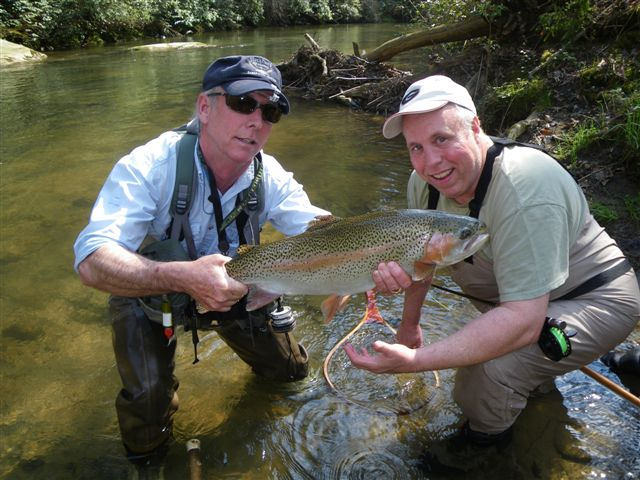 A photo of Andy Brackett with another fisherman